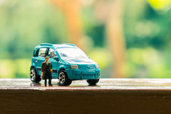 Business figure and toy car Stock Photography