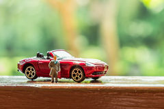 Business figure and toy car Royalty Free Stock Photos
