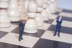 Business Figurine and chess Royalty Free Stock Image