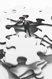 Business figurine on puzzle pieces Stock Photography