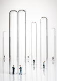 Business figurines and test tubes Royalty Free Stock Photo