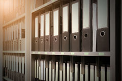Business Files Stacked Paper Files on Shelf . Vintage filter eff. Ect Stock Image