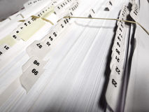 Business Filings Tabs. Several numbered business file tabs on papers and pages in a folder Stock Image