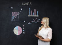Business and finaces concept - smiling business woman presenting. Financial stock photo