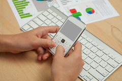 Business, Finanace Diagrams and mobile phone Royalty Free Stock Photography