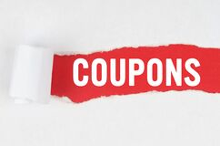 Behind torn white paper on a red background, the text - COUPONS