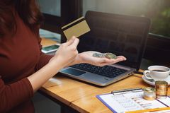 Business and finance concept, Businesswoman using bitcoin and credit card for E-Commerce online shopping.  royalty free stock photo