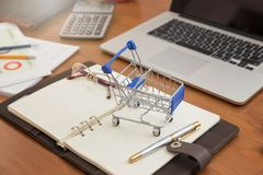 Business and finance concept, Close up shopping cart with credit card and bitcoin on desk for E-Commerce online shopping.  stock photography