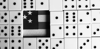 Business and finance concept - dominoes and us dollar. Royalty Free Stock Image
