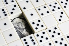 Business and finance concept - dominoes and us dollar. Stock Photo