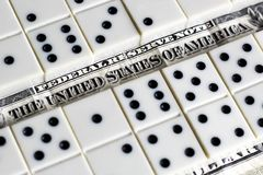 Business and finance concept - dominoes and us dollar. Stock Photography
