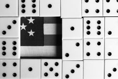 Business and finance concept - dominoes and us dollar. Royalty Free Stock Photos