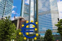 Business and finance concept with giant Euro sign at European Central Bank headquarters in the morning, business district in stock image