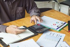 Business and finance concept of office working, Businessman using calculator to calculate sale analysis Chart.  royalty free stock photography