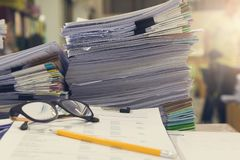 Business and finance concept of office working, Pile of unfinished documents on office desk. Stack of business paper Royalty Free Stock Photography