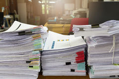 Business and finance concept of office working, Pile of unfinished documents on office desk. Stack of business paper Royalty Free Stock Images