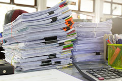 Business and finance concept of office working, Pile of unfinished documents on office desk,. Stack of business paper Stock Photos