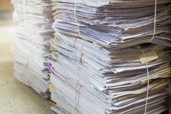 Business and finance concept of office working, Pile of unfinished documents on office desk. Stack of business paper Stock Image
