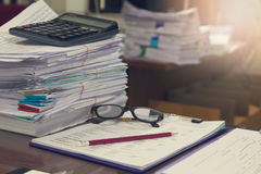 Business and finance concept of office working, Pile of unfinished documents on office desk. Stack of business paper Stock Photo