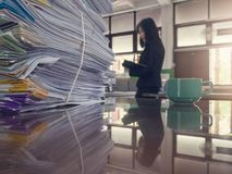Business and finance concept of office working, Pile of unfinished documents on office desk,. Stack of business paper Royalty Free Stock Photos