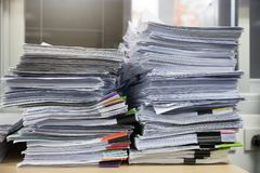 Business and finance concept of office working, Pile of unfinished documents on office desk, Stack of business paper.  stock image