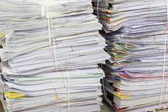 Business and finance concept of office working, Pile of unfinished documents on office desk. Stack of business paper Stock Photography