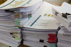Business and finance concept of office working, Pile of unfinished documents on office desk. Stack of business paper Royalty Free Stock Image