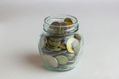 Business, finance, investment, money saving -  coins in glass jar on table Stock Photography