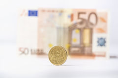 Business, finance, investment, saving and cash concept - close up of euro paper money and coins on table Royalty Free Stock Photos