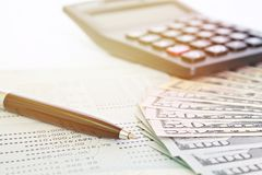 American Dollars cash money, calculator and savings account passbook or financial statement on table. Business, finance, investment, savings or accounting Royalty Free Stock Image