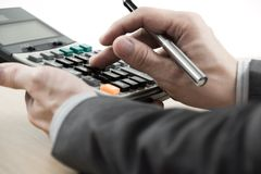 Business finance man calculating budget numbers. On table Royalty Free Stock Photography