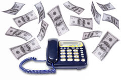 Business and finance. Many dollar falling over the landlines on white background royalty free stock image