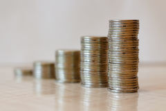 Business Finance and Money concept. Five growing stacks of coins Royalty Free Stock Photo