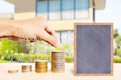 Business finance and real estate concepts. Business finance and real estate concepts, Hand stacking coins, Chalkboard free space for you planing, Business graph Stock Image