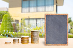 Business finance and real estate concepts. Business finance and real estate concepts, Money coin stack with growing graph, Chalkboard free space for you planing Royalty Free Stock Photo