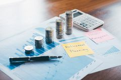 Business finance with report document, stacking coins for step up growing business to profit and saving with wealth management stock image
