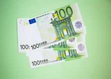 Finance, saving, banking concept - close up bundle of money Euros banknotes on the color background. Business, finance, saving, banking concept - close up bundle royalty free stock photo