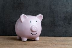 Business or finance saving concept by pink piggy bank on wooden Royalty Free Stock Images