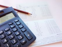 Calculator, pencil and saving account book or financial statement on office desk table Royalty Free Stock Images