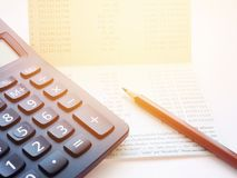 Calculator and pencil on saving account passbook or financial statement Royalty Free Stock Image