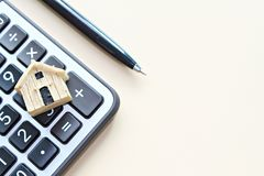 Top view or flat lay of wood house model on calculator with copy space ready for adding or mock up stock photo