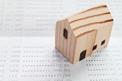Wood house model on financial statements or savings account passbook royalty free stock images