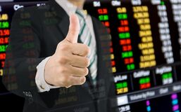 Business finance and stock market get thumbs up from a businessman