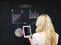 Business and finances concept - smiling business woman. Business and finaces concept - young female smiling presenting finance chart Stock Photos