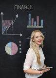 Business and finances concept - smiling business woman. Business and finaces concept - young female smiling presenting finance chart Royalty Free Stock Photo