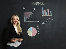 Business and finances concept - smiling business woman. Business and finaces concept - young female smiling presenting finance chart Stock Image