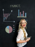 Business and finances concept - smiling business woman. Business and finaces concept - young female smiling presenting finance chart Royalty Free Stock Images