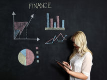 Business and finances concept - smiling business woman. Business and finaces concept - young female smiling presenting finance chart Royalty Free Stock Image
