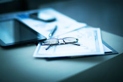 Business financial analysis of the workplace with the glasses on the documents Royalty Free Stock Photography