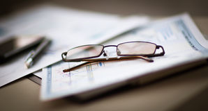 Business Financial Analysis workplace, glasses lie on documents Stock Photography